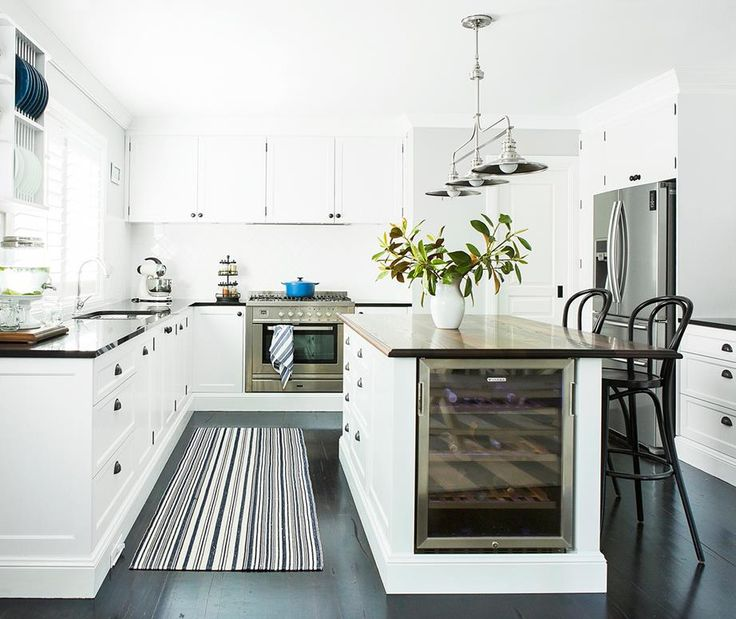 Hamptons style white kitchen with plantation shutters too for Hampton style kitchen stools