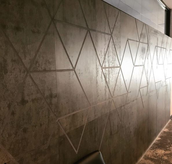 Cnc Routing Over Multiple Concreate Wall Panels Offer Drama To This Feature Wall Wall Panels Feature Wall Concrete Floors