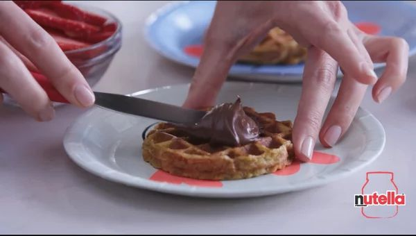 Add some fun to your morning by making French Toast Waffles with  Nutella® hazelnut spread for breakfast! #waffles #frenchtoast #delicious    Discover recipe inspiration at Nutella.com.
