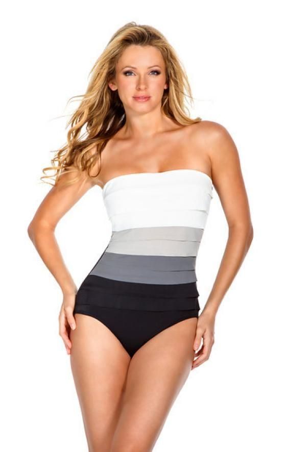 Magicsuit By Miraclesuit Solid Leah Bandeau One Piece Bathing Suit. This swim suit is a neutral beige color, with a Bandeau style top, and tummy control. Magicsuits have a double layer of fabric to provide the best tummy control. Most women go up one size when buying this brand name. Style # 475651. Magicsuit By Miraclesuit Solid Leah Bandeau One Piece Bathing Suit.