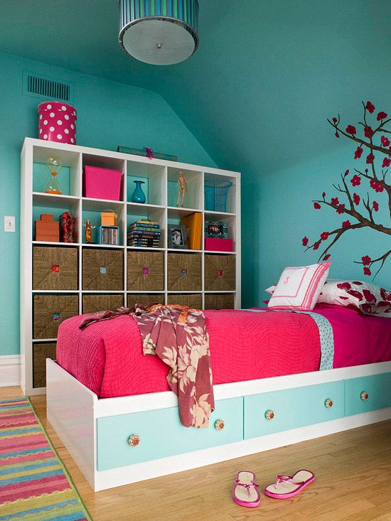 Storage for Kids - Cubbyholes grow up and adapt to tween and teen storage needs. Square baskets fit into the cubbies of this wall shelving unit and give everything a concealed storage spot. Upper cubes provide display space within the same unit. For more kids room decorating and organizing ideas visit https://www.facebook.com/KidsRoomDecor you may find something you 'LIKE'