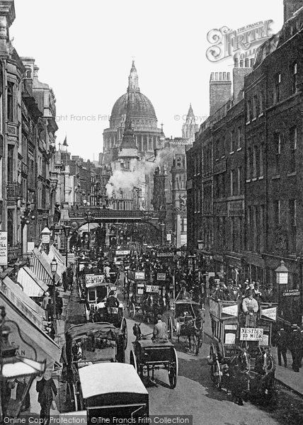 London, Ludgate Hill And Circus 1897. Perched on the summit of Ludgate Hill at almost the highest point in the city, Wren's masterpiece of St Paul's Cathedral is the pride of London. A train has just left Holborn Viaduct Station and thunders south over the bridge, steam ballooning out over the roofs. Below, traffic crawls miserably up Ludgate Hill. In wet weather the road became a quagmire and horses pulling heavy wagons slipped and slid up to St Paul's. #London #HistoricLondon
