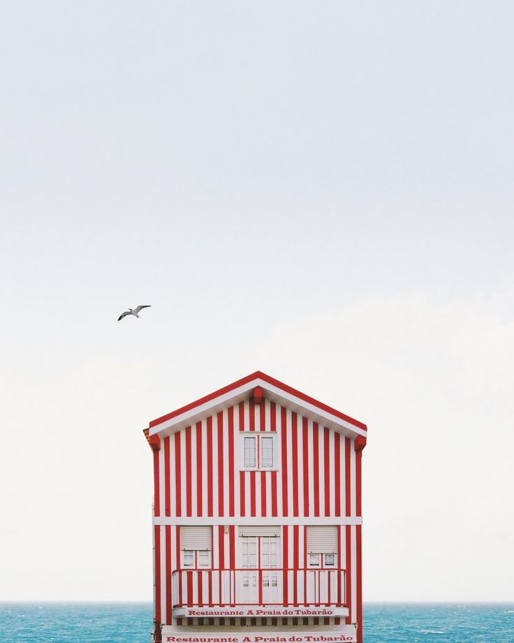 A little red and white beach house, a view of the ocean and the sound of seagulls.