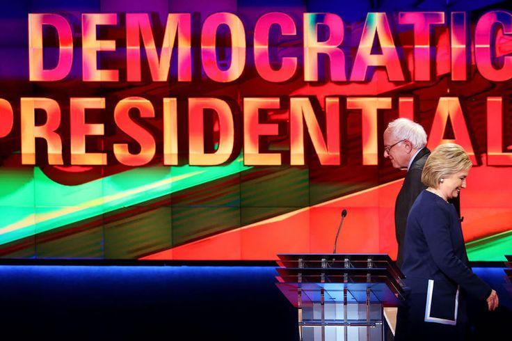 Sen. Bernie Sanders and Hillary Clinton walk off stage during a break in the CNN Democratic Presidential Primary Debate on March 6, 2016 in Flint, Mich. (Photo by Scott Olson/Getty)