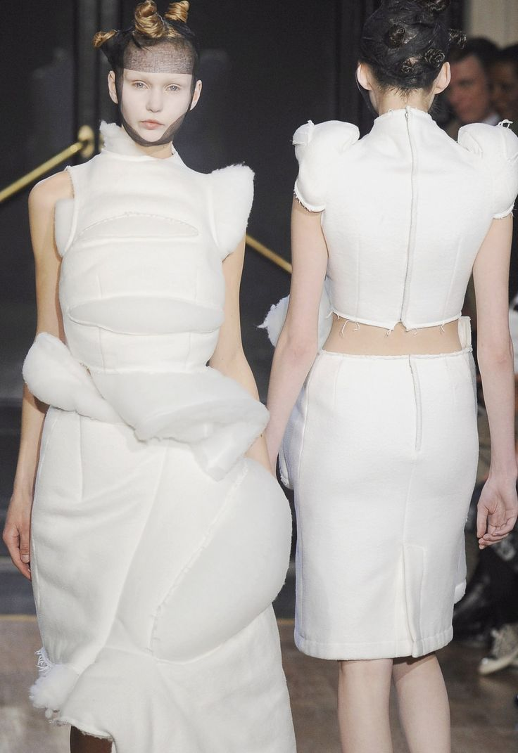 Deconstructed Fashion in clean white with soft padded structure; sculptural 3D fashion design // Comme des Garçons