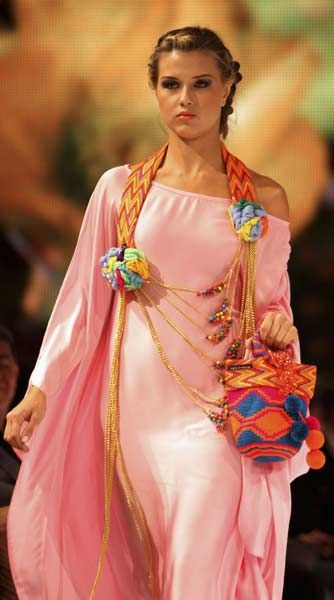 A model presents a creation inspired by native Indian culture by Colombian designer Martha Arredondo during the