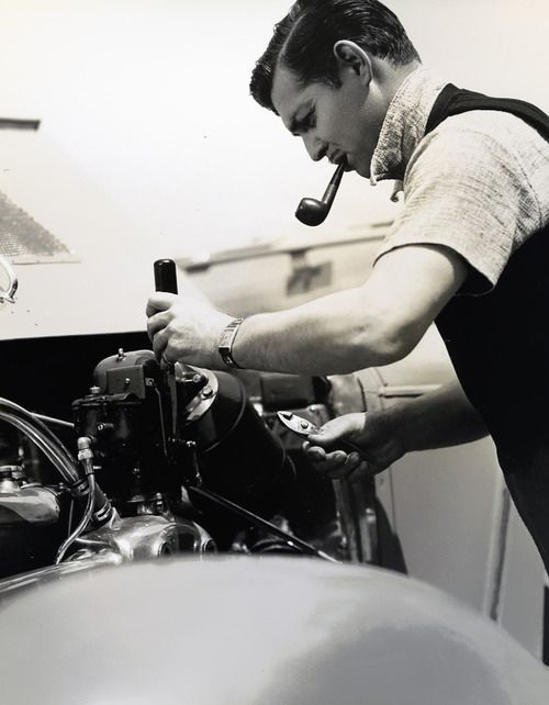 Clark Gable smoking a pipe and doing mechanical work; the epitome of a perfect man for a generation of women.