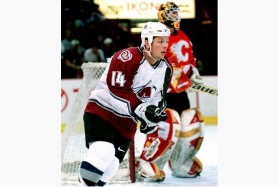 In this 1999 file photo, Colorado Avalanche right winger Theoren Fleury sets up for a shot. Fleury, who is of Metis heritage, is part of a l...