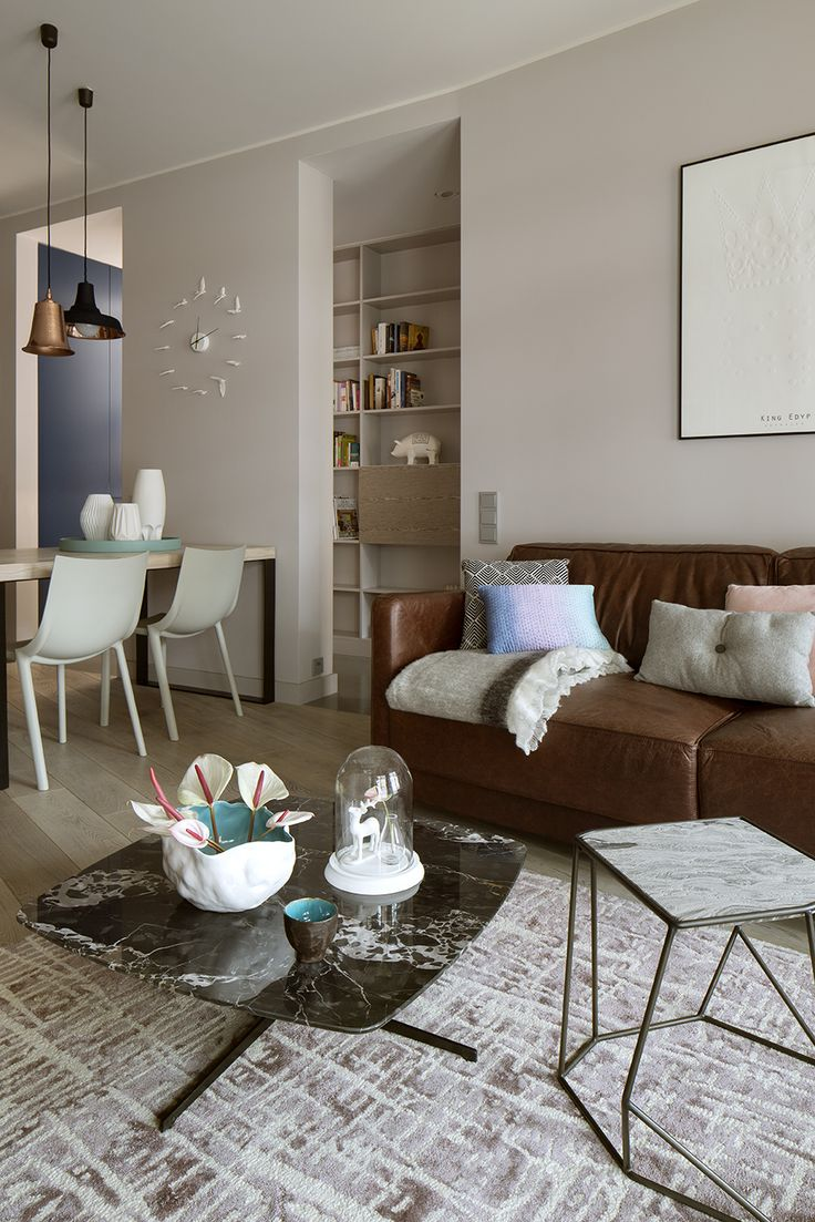 living room, dining room, vintage leather sofa, philip starck chairs, driade bo, designers guild carpet, marble coffee table, small coffee table, decorative colourful cushions