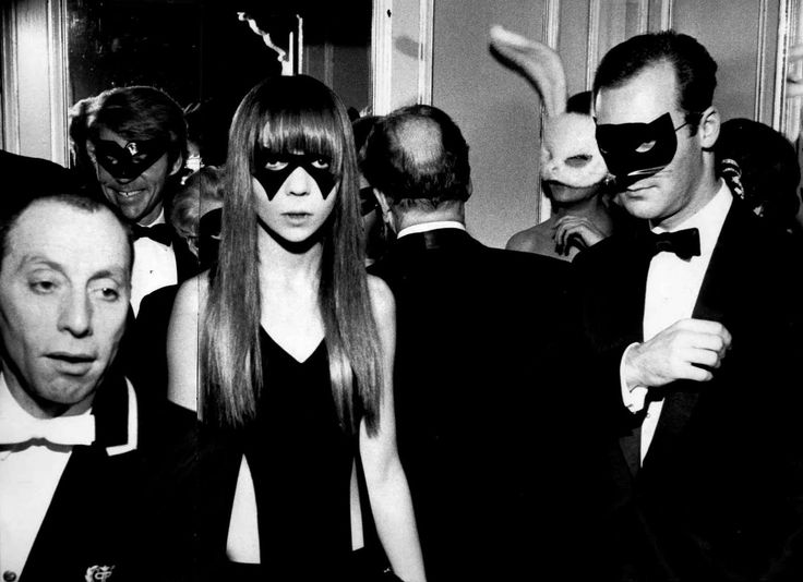 Penelope Tree at the Black & White Ball 1966 - the smiling man over her shoulder is artist Don Bachardy