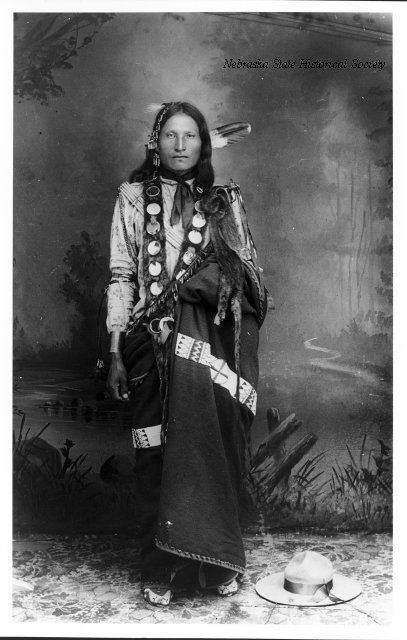 Brule man(Probably Little Horse with feathers and robe). circa 1895. South Dakota, Rosebud Reservation. Photographer: Anderson, John A.