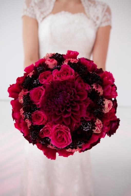 Stunning biedermeier bouquet featuring dahlias, roses and cosmos