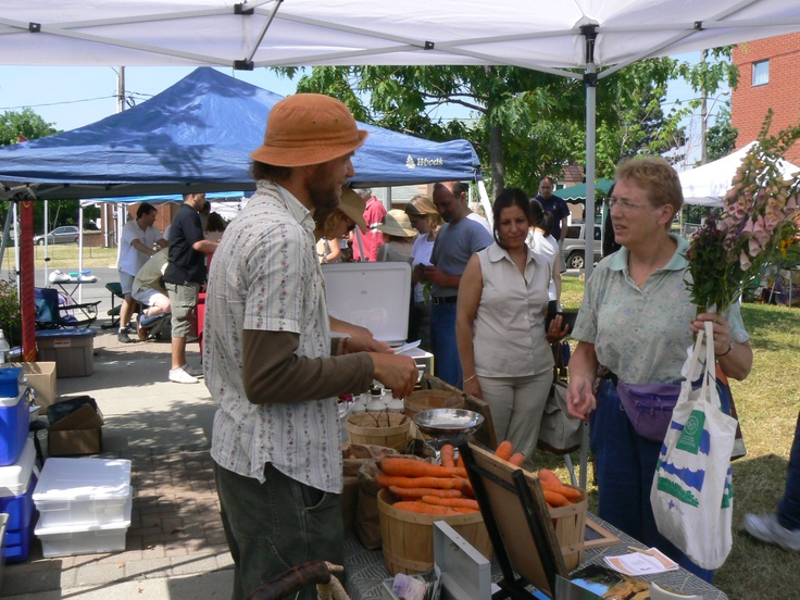 At the farmer's market in Kerr Village Square talking to the Carrot Man