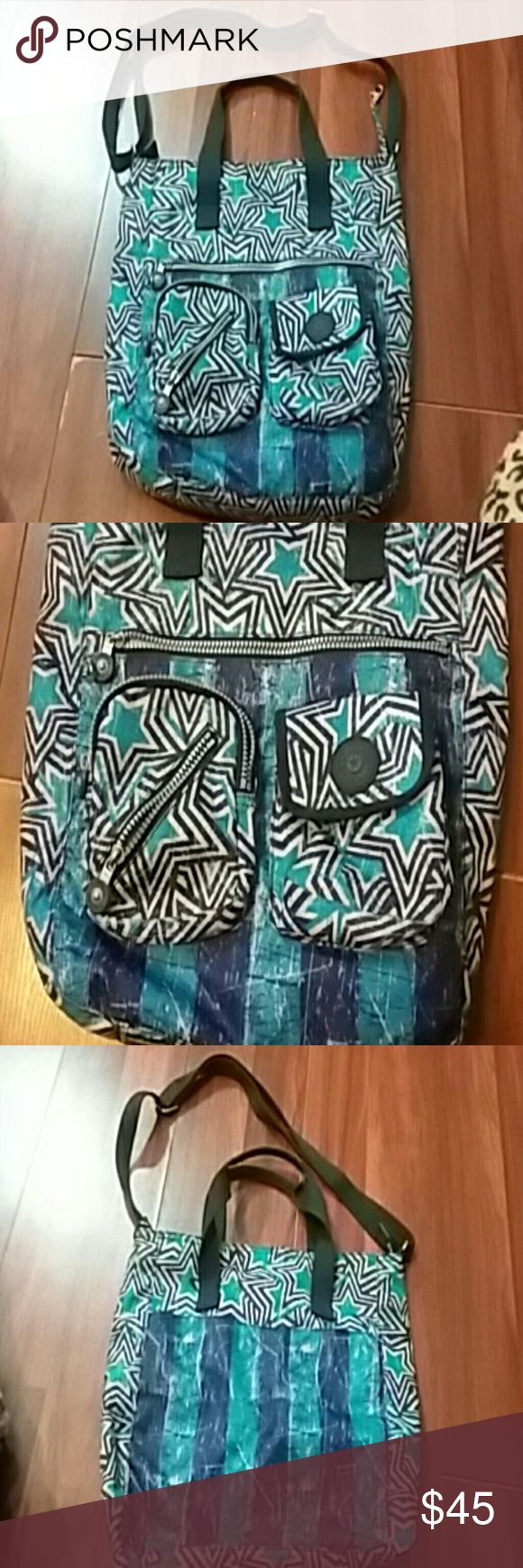 Kipling bag. Very good condition! !!! Nice with lots of space long zipper  in front that opens  two pockets on front  two handle and long strap also cross body bag zipper in side one pocket I n side big pocket on back of bag. Kipling Bags Crossbody Bags