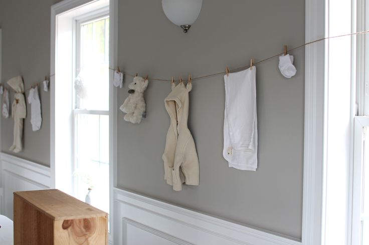ideas for a Gender Neutral Baby Shower  //  clothes line hung with baby outfits