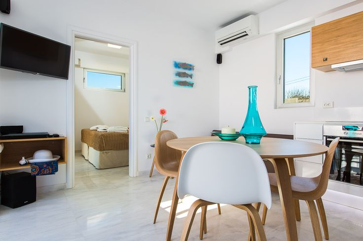www.thalasses.com Thalasses Villas , Villa Eeanthe in Pigianos Kampos, Rethymno, Crete, Greece #vacation_rental #thalasses_villas #4_luxurious_villas #villa_Eeanthe #luxurious_accommodation #summer_holidays #privacy #summer_in_crete #Visit_Greece #indoors #livingroom #dining_area #kitchen_area
