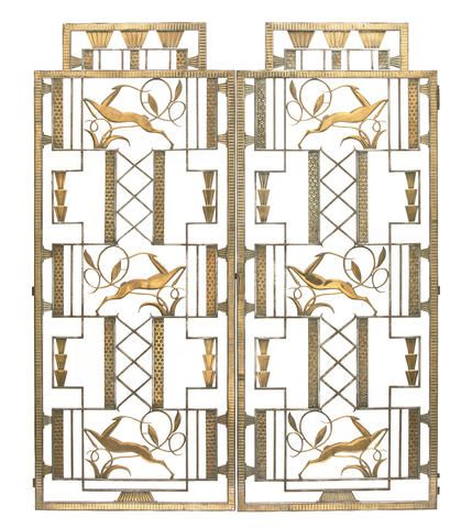 A pair of Edgar Brandt (France) gilt and patinated wrought iron door panels 1920s.  Both elements of nature and geometric design are evident.