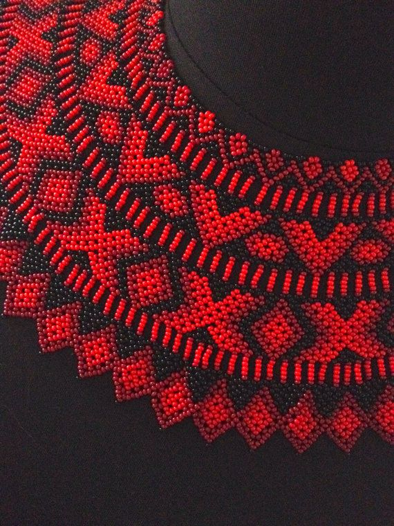 Red and Black hand beaded Saraguro collar necklace. This stunning piece of jewelry will transform your outfit from simple to stellar. Be it jeans and a tee shirt or your little black dress, this necklace is a showstopper. Different shades of red beads offset by black ones create a multi dimensional look.  The width of this collar is 4 inches / 10 cm and it is 17 1/8 inches / 43.5 cm long.    The women of the indigenous Saraguro people are experts in beading and each pattern has...