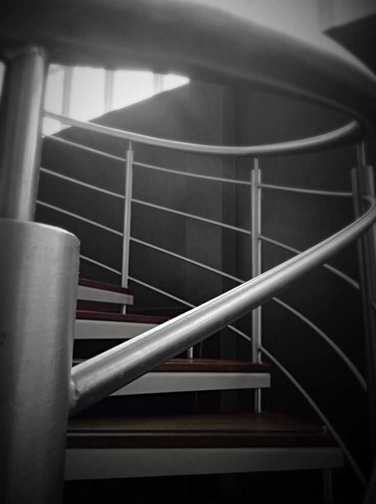 Different angle of spiral stairs in black and white - Villa maribyrnong par grant maggs architects ...