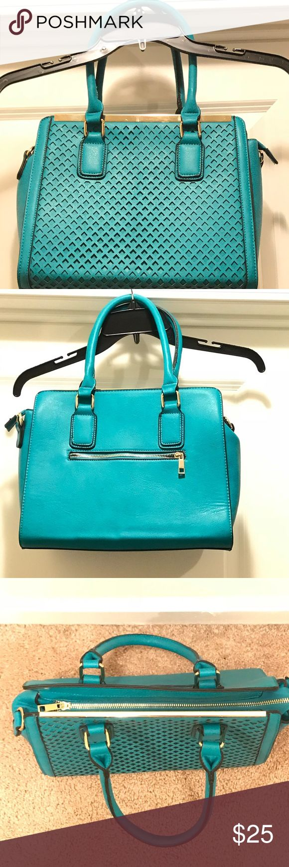 Beautiful Teal Handbag This beautiful teal purse has never been used. It has a matching strap that is included. Nice Gold trim with zipper that is functional. Has separate compartments for storage. Nice design on front. No stains, no damages. Has a nice firm sharp. It was previously purchased from another Posher. Unfortunately their isn't any label to tell what the actual brand is. Bags Shoulder Bags