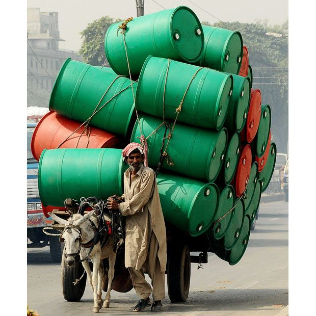 pakistan-I know this is a poor country but, why does this man have to have the smallest animal carry the heaviest load. FOLKS THIS IS ANIMAL ABUSE, we need to stop it