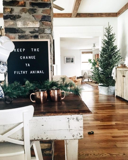 Everything about this: the Christmas tree in a washtub (maybe plaid blanket around bottom?), decor, sign.