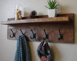 coat hook, shelf for keys/sunglasses and add framed mirror above