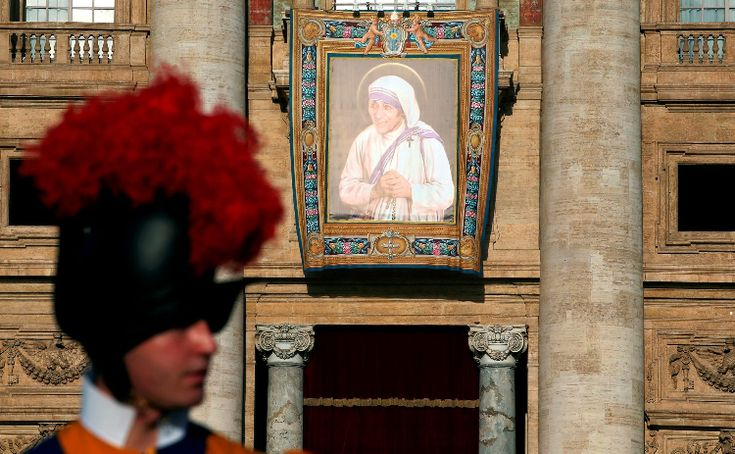 Cardinal Angelo Amato read a brief biography of Mother Teresa's work.