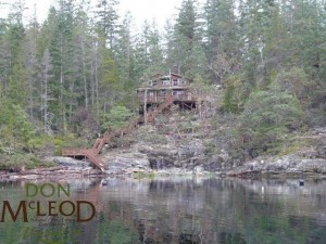Lot 12 Malaspina Estate – Desolation Sound BC - Ocean Front Get-A-Way – Oceanfront home minutes from Okeover Arm Government Dock (boat access only). Vacation home in picturesque Okeover Arm, the gateway to Desolation Sound. Quality workmanship inside & out. Vaulted ceilings, solid pine interior, wood stove, laminate flooring, & upper loft with 2 spacious bedrooms. Private wraparound sundeck, stairway to Beach. Additional 12×10 deck at the beach overlooking ocean views.