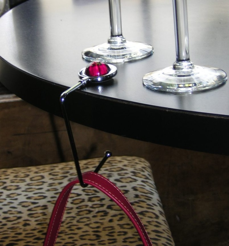 A folding handbag hook from My Bag Hanger is the answer. Affordable, portable and secure, our handbag hook is a convenient accessory that attaches to any table and keeps your bag in sight and by your side, no matter where you are.