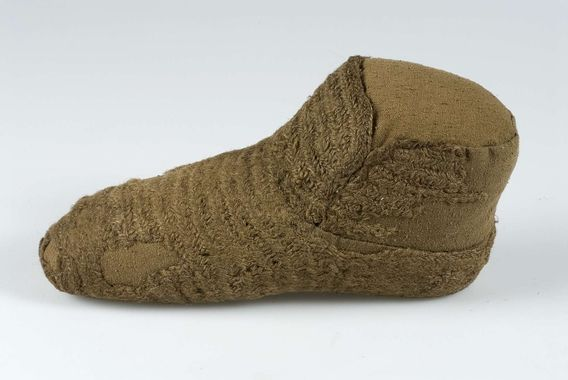 Nalbound sock, Uppsala, Sweden. Late medieval. Length 21 cm, height (ankle) 5 cm.