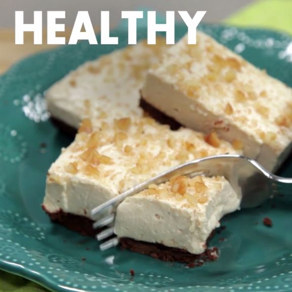 Our favorite part of these creamy, sweet-and-salty bars is the crust: Melted chocolate and just a little bit of butter make it crunchy without baking. Plus, you can skip the full fat sour cream in the cheesecake layer.