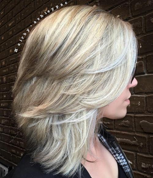 Medium Layered Haircut More                                                                                                                                                                                 More