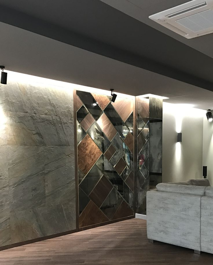 Office interior. Panel made of stone veneer, American walnut veneer in combination with mirrors. Mirrors are aged manually.