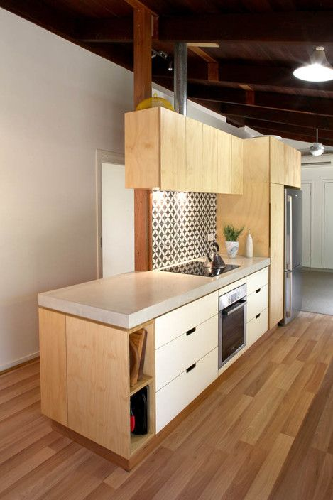 Plywood Kitchen With White Osmo Oil Finish And Concrete