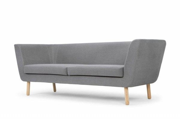 """esigner Jesper Ståhl focuses on the details with his new family of upholstery furniture called 'Nest'. The absence of cushions creates a focus on the sofa's profile and its stitching. """"I wanted to design a sofa with an inviting corner that one can creep up in, almost like a bird in a nest,"""" Jesper Ståhl explains. """"But it was important that the sofa should look good from all directions and that is why it slopes and is rounded towards the bottom."""""""