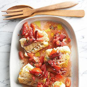 Rosemary Cod with Plum-Tomato Sauce | Plums and tomatoes pair up to form the irresistible rosemary-infused sauce in Top Chef Stephanie Izard's cod recipe that features a bit of salty flavor from fish sauce.