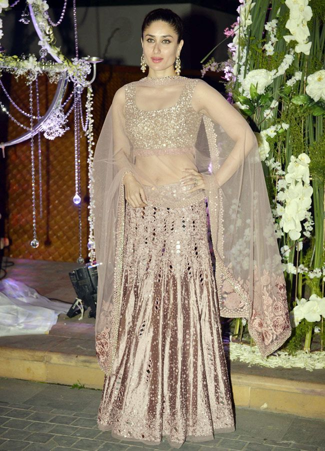Kareena Kapoor wearing a copper lehenga, looking spectacular at Manish Malhotra's niece Riddhi's sangeet.