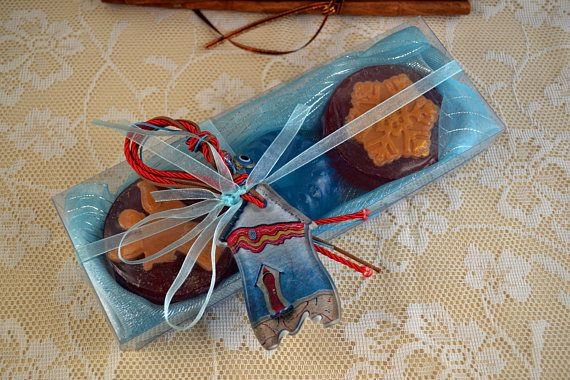 Luxury Blue Azure Turquoise Christmas Handmade Gift Set with three small Glycerin Scented Soaps (two red Color with Christmas shapes, amber scent, one Blue Azure Color, Jasmine scent) and a lovely handmade glass Christmas Charm for Good Luck in the packaging.  A very elegant, stylish gift for Christmas !