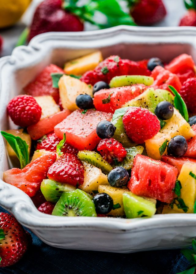 This Mixed Fruit with Lemon-Basil Dressing is super refreshing and delicious with an incredible savory dressing. Perfect for summer!