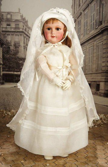 """26""""- All-Original French Composition Doll in Original Communion Costume by SFBJ~~~Marks: SFBJ Paris 301 12. Comments: SFBJ, circa 1920. Value Points: in flawless original unplayed with condition, the doll wears original organdy communion dress with matching veil, undergarments, stockings, pocket purse, cream kidskin shoes, and perfectly-fitted white kidskin gloves."""