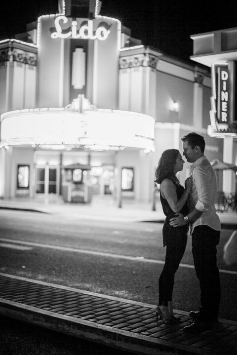Newport Beach, Orange County photographer, Newport Beach weddings, creative engagement portraits, engagement session, Lido Theater, couple, black and white pictures, old theatre, movie portraits, Movie theater, engagement session, posing, night photography