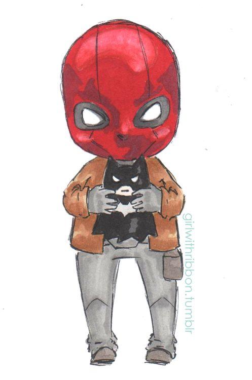 Little Jason Todd with a Batman toy