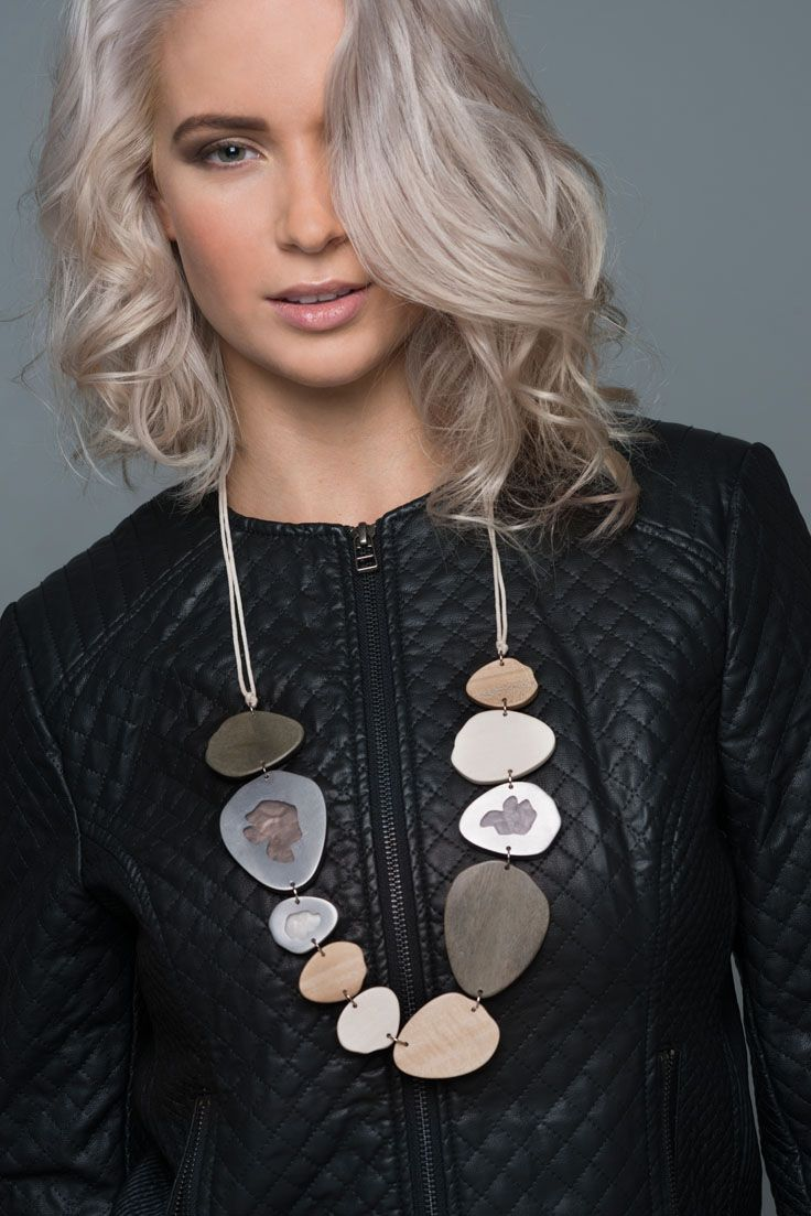 Ragged blossom necklace. Contemporary, and natural our Ragged blossom necklace is simply stunning - perfect for any special occasion. It looks amazing worn with neutral block colours. Irregular shaped metal, wood and resin rings drop elegantly from an adjustable cord. Teamed with our Riverstone earrings and rings, it is the perfect accessory for making a statement.