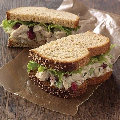 Starbucks Tarragon Chicken Salad Sandwich - 2 Cups Cooked Chicken; 1/4 Cup Dried Cranberries, Finely Chopped; 1 Stalk Celery, Finely Chopped; 1 Teaspoon Lemon Juice; 1/4 Cup Mayonnaise; 1-2 Teaspoons Dried Tarragon; Salt  Pepper on Wheat Bread w/ Romaine Lettuce