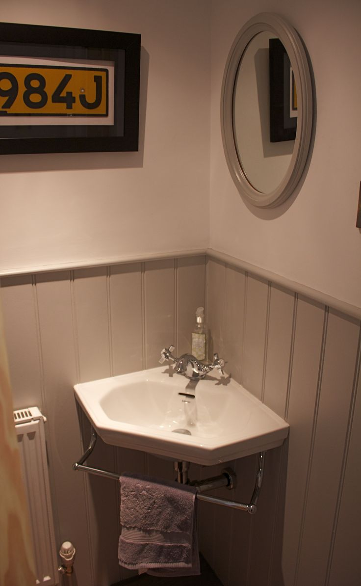 Under the stairs WC with grey tongue and groove and adorable little corner sink