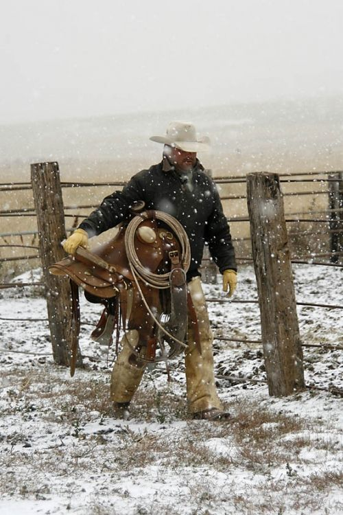 """The American Cowboy - Symbol of the American West"" Photography Workshop - Cowboy in Snow by Les Voorhis - Fall 2009 Workshop - Photos from our Nature Photography Workshops"