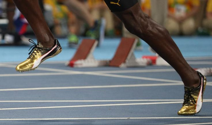 Usain Bolt of Jamaica runs to win the gold, ahead of Justin Gatlin  of the U.S…