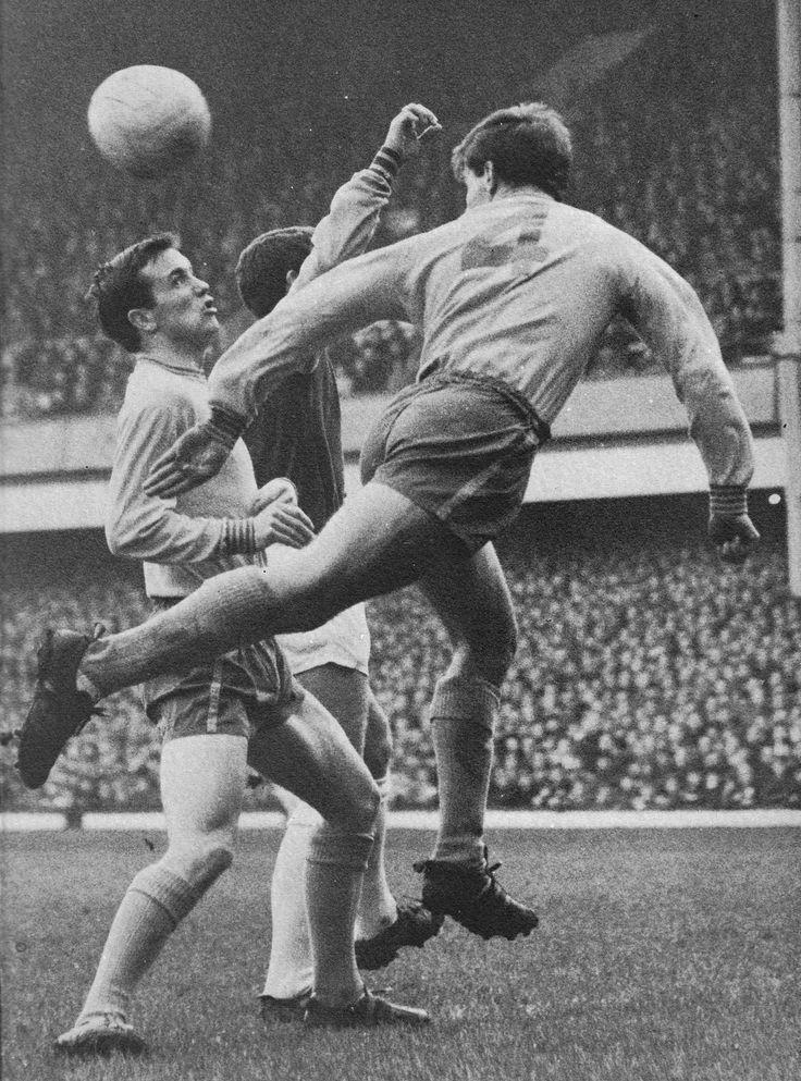 13th November 1965. Chelsea duo John Hollins and Bert Murray thwart West Ham United inside forward Geoff Hurst.