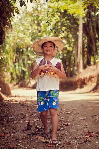 Farmer boy with banana blossoms